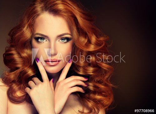 girl model with long red wavy hair big curls on the red head hairstyle permanent waving A
